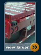 hydraroll flat red trailer with roller track