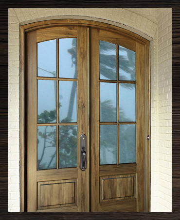 Tiffany 6 lite tdl arch top mahogany double entry door for Impact rated doors