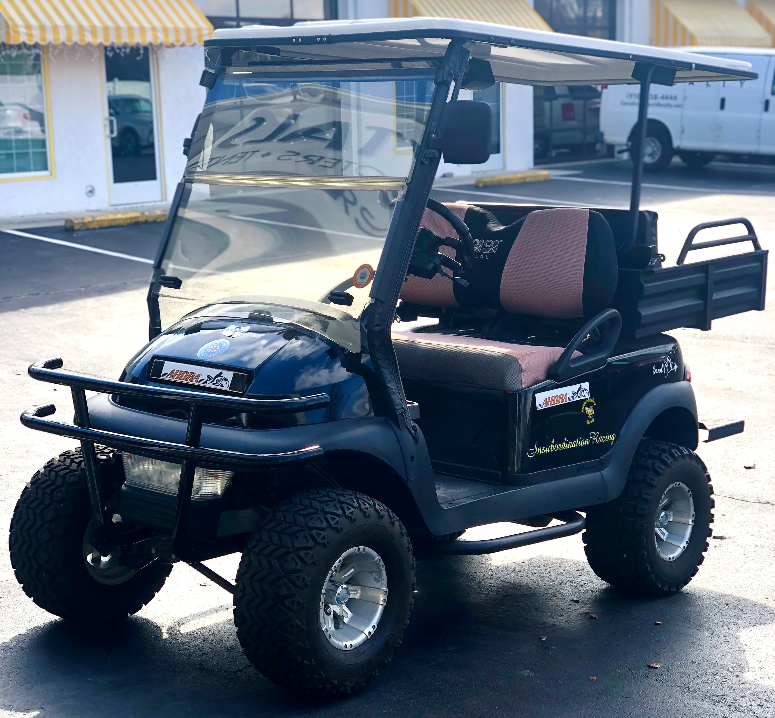 4 PASSENGER LIFTED CLUB CAR GAS CART WITH UTILITY BED **CONSIGNMENT**